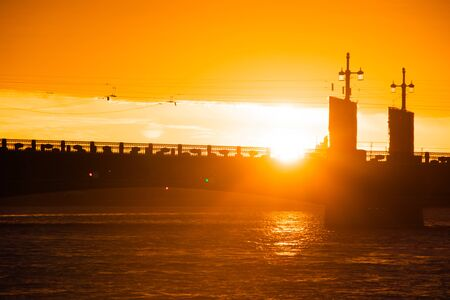 The bridges are erected at dawn in St. Petersburg. Peter Romance. Sight of Peter. Neva River. Dawn in the city. White Nights. Drawbridges Stock Photo