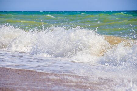 Sea waves. Sea of Crimea. High waves in clear weather. Sunny day at sea. Background blue waves. Sand beach. Clean beach. Sea without people.