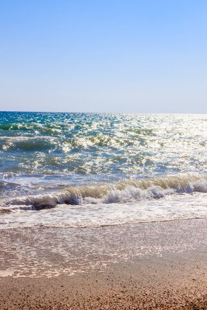Sea waves. Sea of Crimea. High waves in clear weather. Sunny day at sea. Background blue waves. Sand beach. Clean beach. Sea without people. Stockfoto
