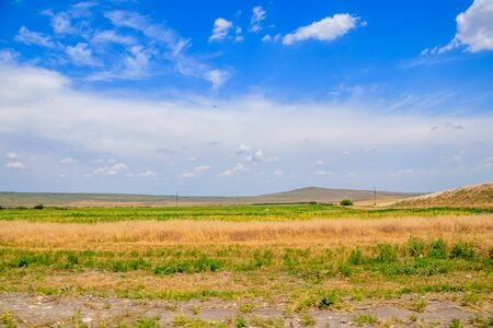 Russian open spaces. Crimea. Field. Summer Russian landscapes. Road views. Grass and sky. Background summer landscape. Crimean fields 免版税图像