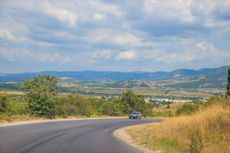 Russian paved roads. Background road. Roads in the mountains of Crimea. Travel by car. Road views.