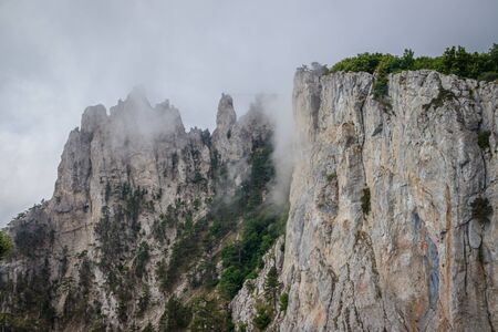 Ai-petri mountain in the fog. High mountain. Crimea. Russian mountains. Low clouds. Beautiful mountain landscape. The famous AI Petri mountain, partially covered with clouds, fog, one of the highest points of the Crimea, is majestic and beautiful.
