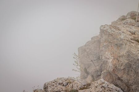 Ai-petri mountain in the fog. High mountain. Crimea. Russian mountains. Low clouds. Beautiful mountain landscape. The famous AI Petri mountain, partially covered with clouds, fog, one of the highest points of the Crimea, is majestic and beautiful. 免版税图像
