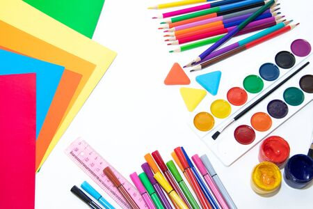 Back to school. Preparing for the school year. Stationery isolated on a white background. Bright stationery. Hello school. Stationery layout on a white background. Isolated objects