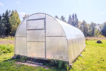 Greenhouse. Bright greenhouse in the garden. Agricultural harvest. Indoor stationary greenhouse Stockfoto