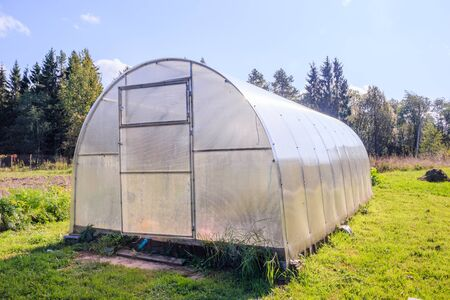 Greenhouse. Bright greenhouse in the garden. Agricultural harvest. Indoor stationary greenhouse 免版税图像