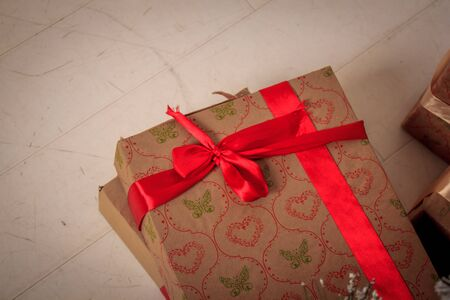 New Year's gift lies under the Christmas tree. New Year's and Christmas. Cristmas presents. Packaged Gifts Stock Photo