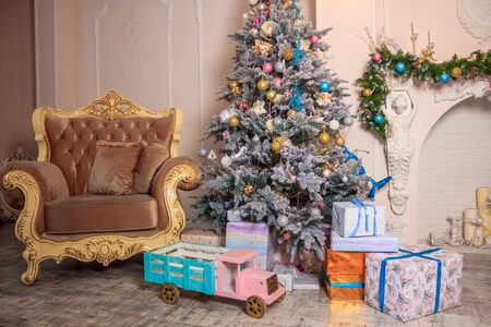 New Years decor of a living room. Christmas. Holiday room decorations. Christmas toys and garlands Stok Fotoğraf