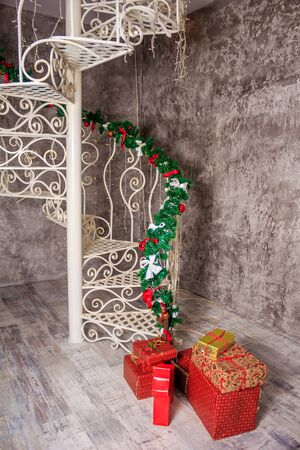 New Year's decor of a living room. Christmas. Holiday room decorations. Christmas toys and garlands Stok Fotoğraf - 132115832