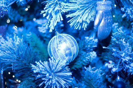 New years toys on the Christmas tree. Christmas tree decorations. Holiday New year and Christmas. Postcard