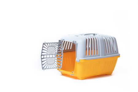 Carrier for cats and small dogs isolated on a white background. safe transportation of animals, article about the transportation of animals. Isolated white background. Gray plastic carry for cats. Veterinary Medicine Article about veterinarians