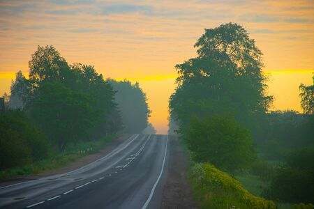 Highway at dawn . Beautiful road. Road landscape. Travel by car. The article is about travel.