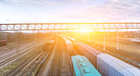 Commodity cars on the railway. Cargo transportation. Panorama of wagons awaiting loading. Russian railway. Turnover. Russia, Tosno, April 20, 2020