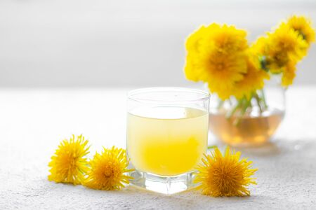Dandelion tea. Yellow summer flowers dandelions. Tea party Homemade drink. Certified flower tea. Yellow drink. An article about teas. Hot drinks article