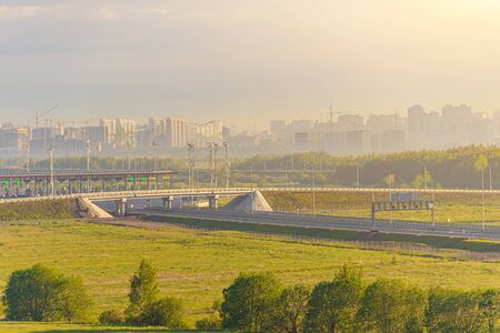 View of the toll road. View of the road. City view. Summer landscape. The morning dawn. Sunlight. M11 Russia.