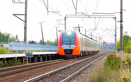 The electric train swallow approaches the platform. Public transport. Cancellation of trains. Decrease in transport. Russian railway. Russia Old Mozino August 11, 2019