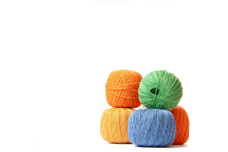 Colored balls of crochet thread on a white background 版權商用圖片