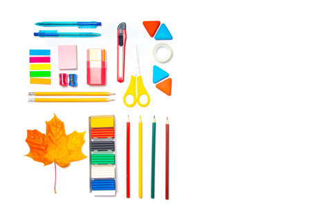 Office supplies layout on a white background copy space . School supplies. Colored stationery. Isolated background. Article about preparing for the school year. Copy space