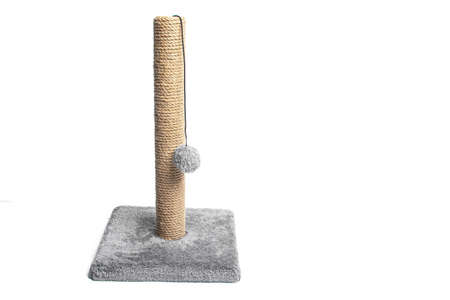 Isolated scratching post on a white background . Pet products. Grey scratching post. Games for animals. Copy space. Article about choosing a scratching post for cats.