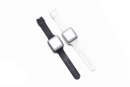 Electronic wrist watch on a white background . White and black wrist watches. Womens and mens watches. Isolated background. Article about modern watches. Article about choosing a watch.