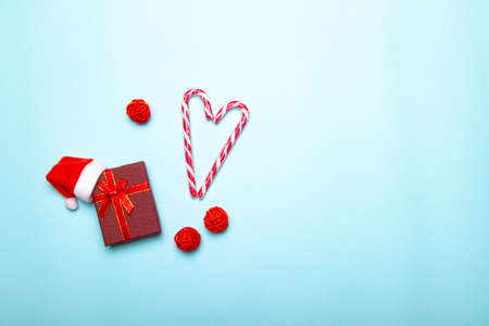 Christmas red gift on a blue background. Gift and candy. Christmas layout. Holiday. New Year. Gifts. Article about choosing gifts.