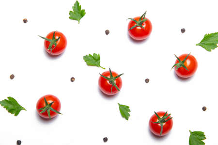 Cherry tomatoes on a white background . Background vegetables. Copy space. Small tomatoes. Article about tomatoes. decoration