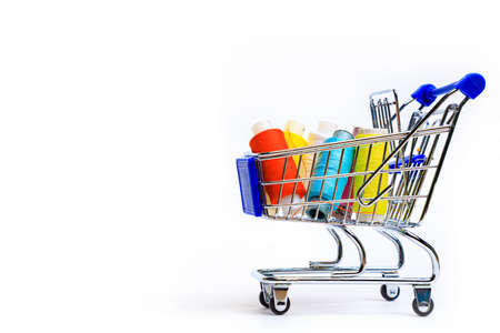 Trolley with thread on a white background. Thread selection. Shopping for needlework. White background. Copy space Reklamní fotografie