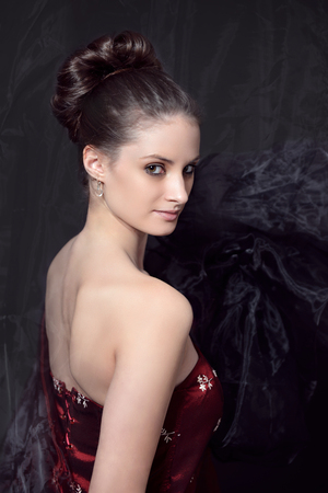red corset: portrait of young woman in red corset Stock Photo