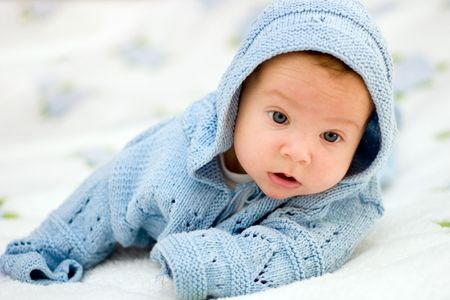 portret: Portret of a baby in blue jacket