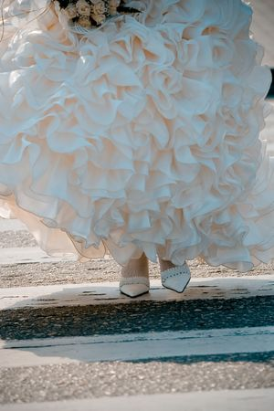 A bride crossing road on zebra, foots close-up. photo