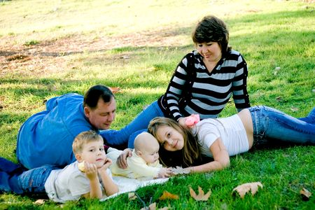 Mother with father and with three kids relaxing on meadow Stock Photo - 2051920