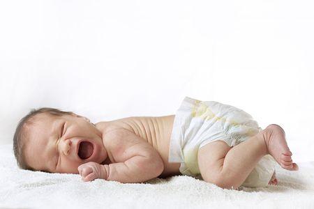 Small newborn child yawning or crying on white background Stock Photo