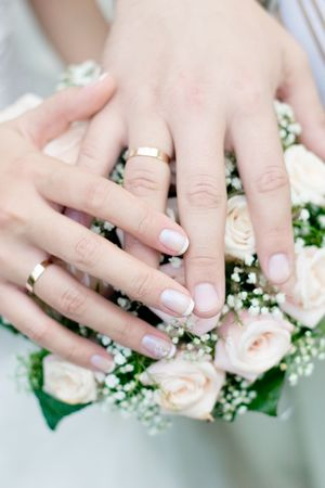 Wedding bouquet from pastel pink roses, hands and rings Stock Photo - 2371348