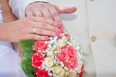 Wedding bouquet from white and ping roses, hands and rings Stock Photo - 2400362
