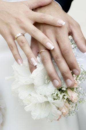 Wedding bouquet from white and pastel pink flowers, hands and rings Stock Photo - 2430224