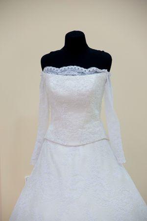 Wedding dress on black mannequin photo