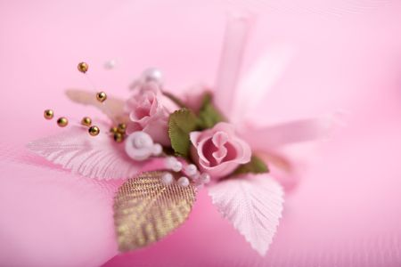buttonhole: Wedding floral buttonhole on pink background Stock Photo