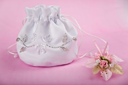 buttonhole: Bridal handbag and buttonhole on pink background