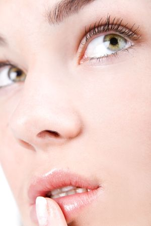 Beautiful woman face with staring shiny eyes close-up photo
