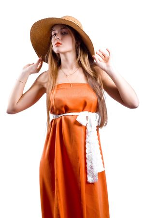 Model with beautiful long hair posing in orange dress and hat isolated on white photo