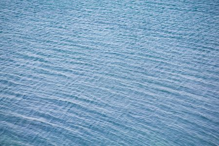Blue rippled sea water texture photo