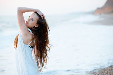Glamour portrait of young slim model with long hair during sunset at beach Stock Photo - 3049622