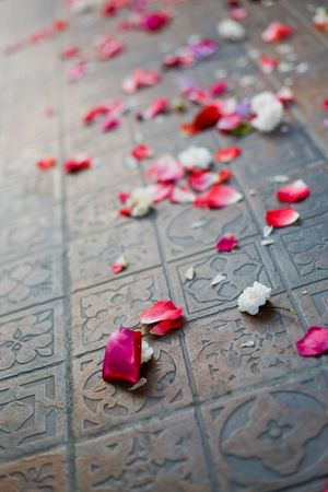 Sparse rose petals on the floor after  ceremony.