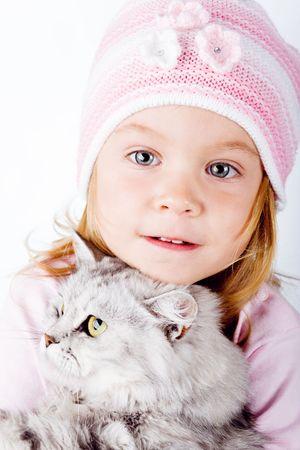 Lovely little girl with kitten on white background studio shot photo