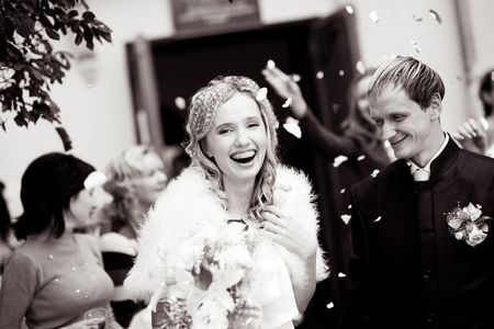 croud: Laughing bride and groom during wedding ceremony Stock Photo