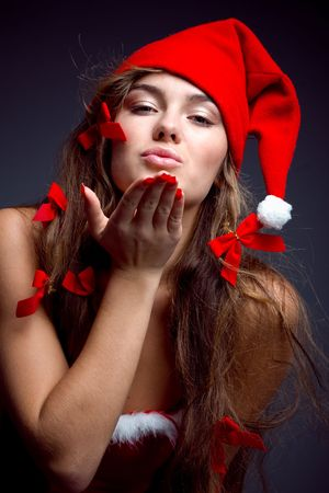 Santa helper girl giving a kiss to you photo