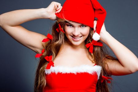 Beautiful smiling Santa helper girl photo