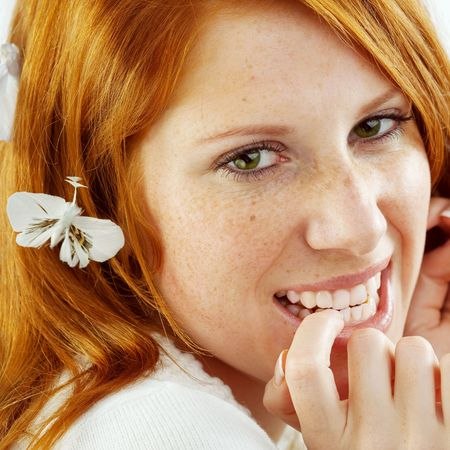 Photo of beautiful young girl with red hair and freckled skin on her face, square composition Stock Photo - 3988523
