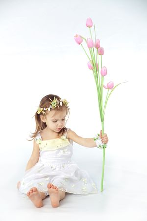 Little girl in spring flower dress isolated on white background with tulips Stock Photo - 4325157