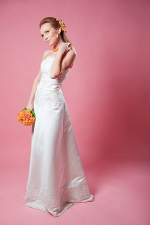 Beautiful bride posing on pink background Stock Photo - 4487189